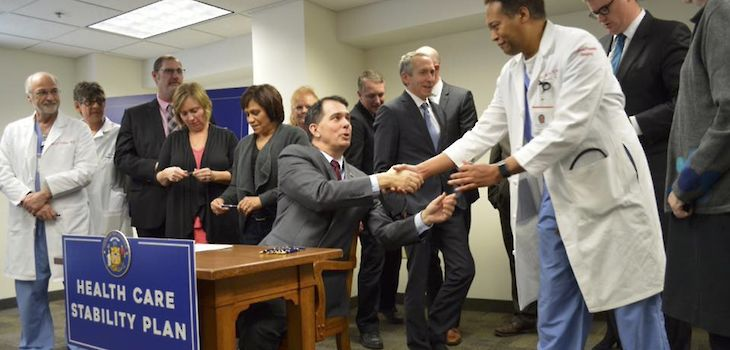 Walker Signs Bill Into Law Designed to Lower Insurance Premiums